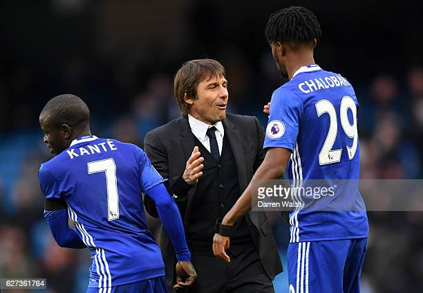 Antonio Conte Manager of Chelsea congratulates Nathaniel Chalobah and N'Golo Kante after their 31 win in the Premier League match between Manchester...