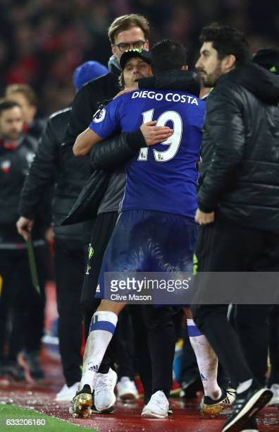 Antonio Conte Manager of Chelsea consoles Diego Costa at the final whistle in the Premier League match between Liverpool and Chelsea at Anfield on...