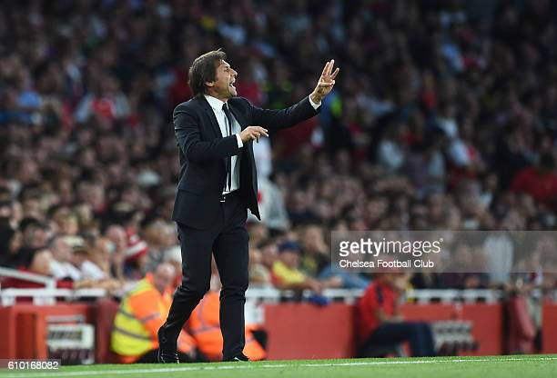 Antonio Conte Manager of Chelsea directs his players during the Premier League match between Arsenal and Chelsea at the Emirates Stadium on September...
