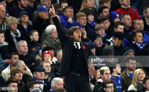 Antonio Conte Manager of Chelsea gives his team instructions during the Premier League match between Chelsea and Everton at Stamford Bridge on...