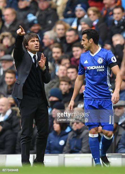 Antonio Conte Manager of Chelsea gives instruction to Pedro during the Premier League match between Manchester City and Chelsea at Etihad Stadium on...