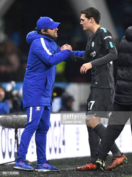 Antonio Conte Manager of Chelsea greets Andreas Christensen after he is substituted off during the Premier League match between Huddersfield Town and...