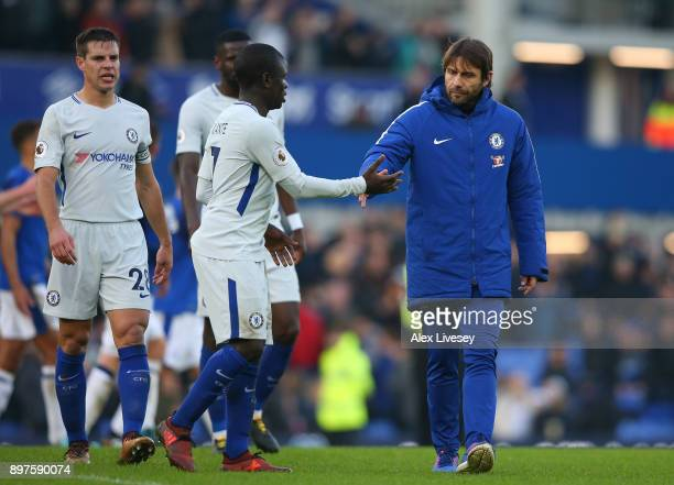 Antonio Conte Manager of Chelsea greets N'Golo Kante after the Premier League match between Everton and Chelsea at Goodison Park on December 23 2017...