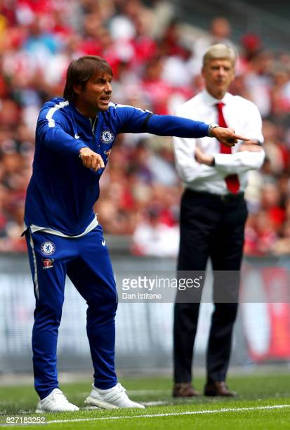 Antonio Conte manager of Chelsea issues instructions from the touchline next to Arsene Wenger manager of Arsenal during the FA Community Shield match...