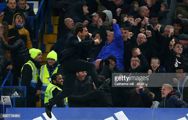 Antonio Conte manager of Chelsea jumps in the air to celebrate after Willian of Chelsea scores a goal to make it 32 during the Premier League match...