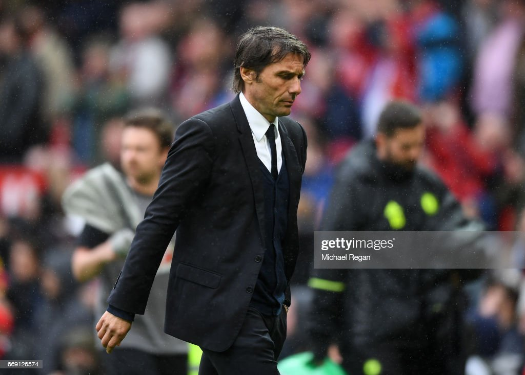 Antonio Conte, Manager of Chelsea looks dejected after the Premier League match between Manchester United and Chelsea at Old Trafford on April 16, 2017 in Manchester, England.