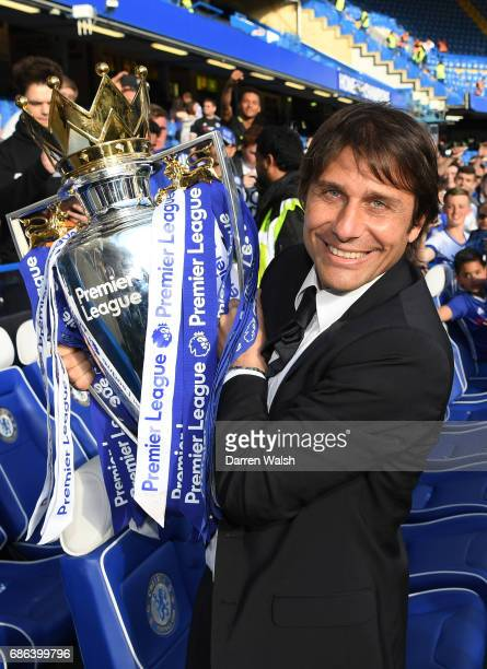 Antonio Conte Manager of Chelsea poses with the Premier League Trophy after the Premier League match between Chelsea and Sunderland at Stamford...