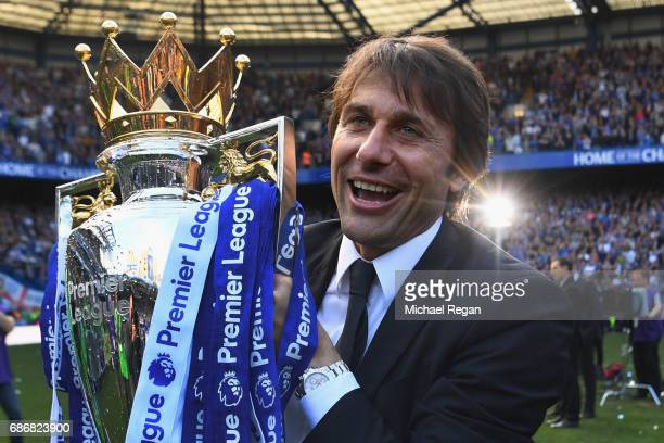 Antonio Conte, Manager of Chelsea poses with the Premier League Trophy after the Premier League match between Chelsea and Sunderland at Stamford...