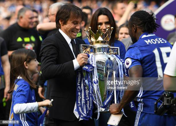 Antonio Conte, Manager of Chelsea prepares to lift the Premier Leauge Trophy after the Premier League match between Chelsea and Sunderland at...