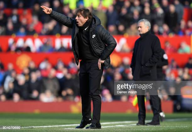 Antonio Conte Manager of Chelsea reacts as Jose Mourinho Manager of Manchester United looks on during the Premier League match between Manchester...
