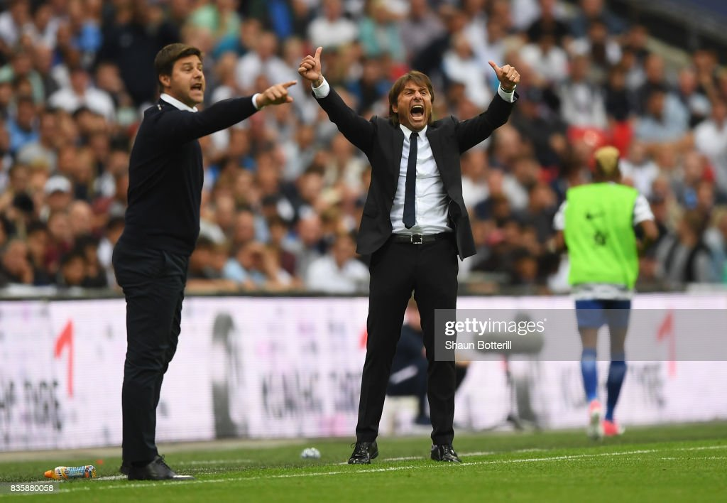 Antonio Conte, Manager of Chelsea reacts as Mauricio Pochettino, Manager of Tottenham Hotspur gives his team instructions during the Premier League match between Tottenham Hotspur and Chelsea at Wembley Stadium on August 20, 2017 in London, England.
