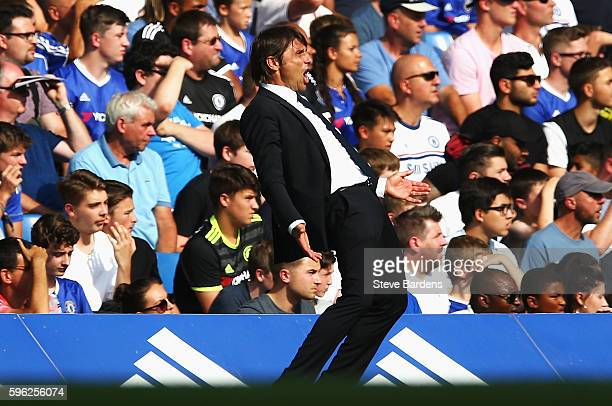 Antonio Conte Manager of Chelsea reacts during the Premier League match between Chelsea and Burnley at Stamford Bridge on August 27 2016 in London...