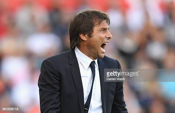 Antonio Conte manager of Chelsea reacts during the Premier League match between Swansea City and Chelsea at Liberty Stadium on September 11 2016 in...