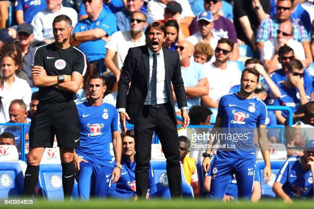 Antonio Conte Manager of Chelsea shouts from the sideline during the Premier League match between Chelsea and Everton at Stamford Bridge on August 27...
