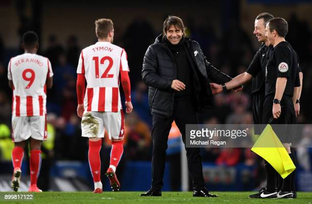 Antonio Conte Manager of Chelsea smiles with referee Kevin Friend after the Premier League match between Chelsea and Stoke City at Stamford Bridge on...