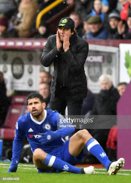 Antonio Conte Manager of Chelsea speaks to his side as Diego Costa of Chelsea looks on during the Premier League match between Burnley and Chelsea at...