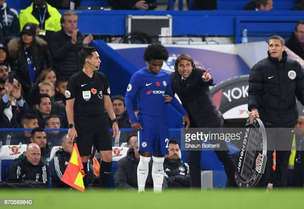 Antonio Conte Manager of Chelsea speaks to Willian of Chelsea during the Premier League match between Chelsea and Manchester United at Stamford...
