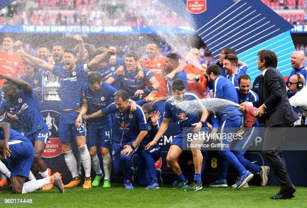 Antonio Conte Manager of Chelsea sprays his team with Champagne following his sides victory in The Emirates FA Cup Final between Chelsea and...
