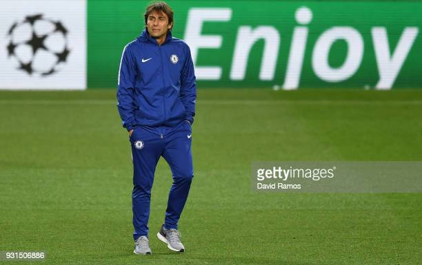 Antonio Conte Manager of Chelsea walks across the pitch during a Chelsea training session on the eve of their UEFA Champions League round of 16 match...