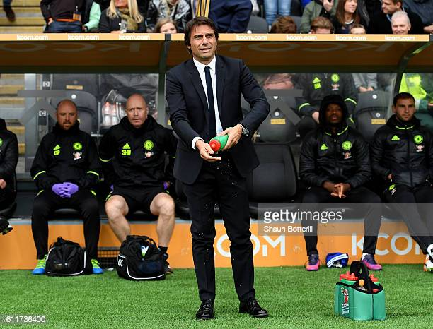 Antonio Conte Manager of Chelsea washes his hands with some water piror to kick off during the Premier League match between Hull City and Chelsea at...