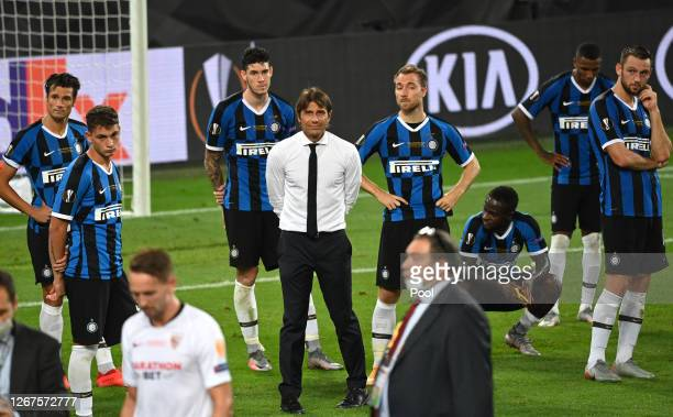 Antonio Conte Manager of Inter Milan and his players look dejected on pitch following the UEFA Europa League Final between Seville and FC...