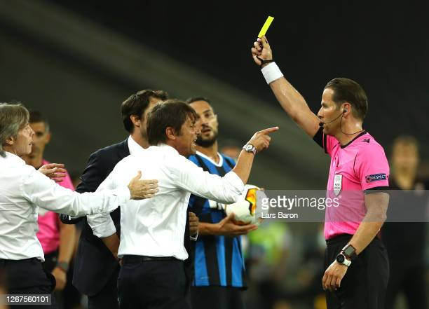 Antonio Conte, Manager of Inter Milan is shown a yellow card by Match Referee, Danny Makkelie during the UEFA Europa League Final between Seville and...