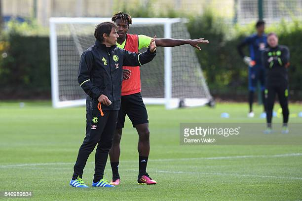 Antonio Conte Nathaniel Chalobah at Chelsea Training Ground on July 13 2016 in Cobham England