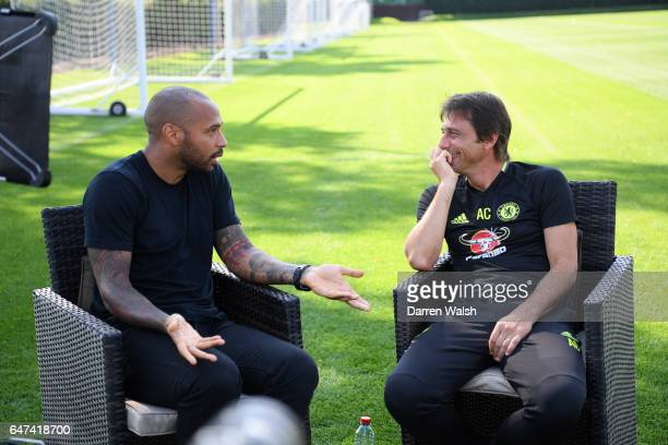 Antonio Conte of Chelsea is interviewed by Thierry Henry for Sky after the Chelsea Official Team Group at the Cobham Training Ground on September 13...
