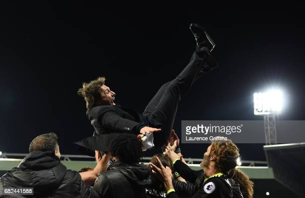 Antonio Conte of Chelsea is thrown in the air by his player after winning the title after the Premier League match between West Bromwich Albion and...