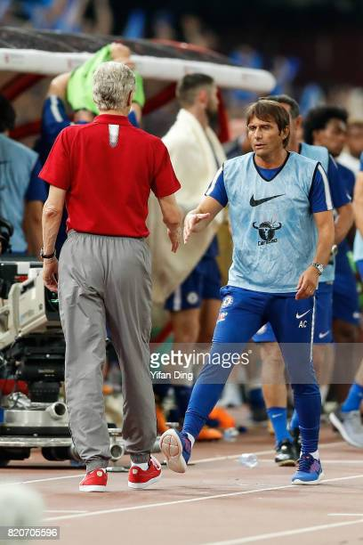 Antonio Conte of Chelsea shakes hands with Arsene Wenger of Arsenal after the PreSeason Friendly match between Arsenal FC and Chelsea FC at Birds...