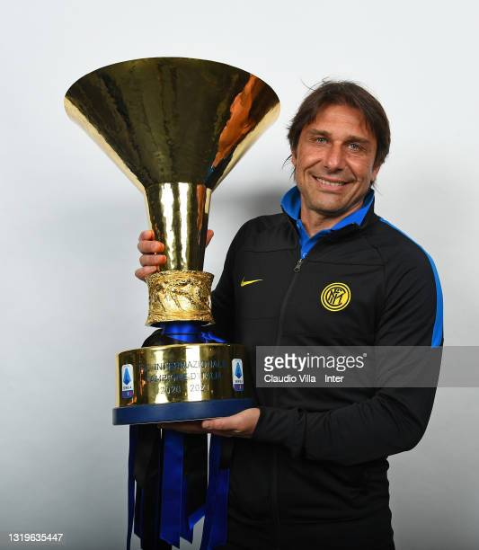 """Antonio Conte of FC Internazionale poses with the trophy for the victory of """"scudetto"""" at the end of the last Serie A match between FC Internazionale..."""