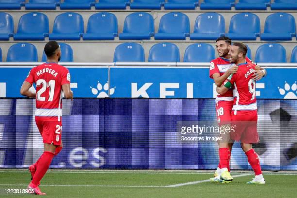 Antonio Cortes Heredia of Granada celebrates 01 with Roberto Soldado of Granada Yangel Herrera of Granada during the La Liga Santander match between...