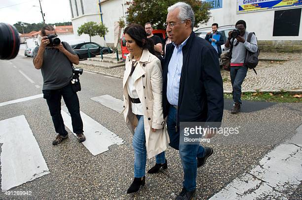 Antonio Costa, leader of the Socialist party , right, with his wife Fernanda Tadeu, leaves a polling station after casting his ballot during the...