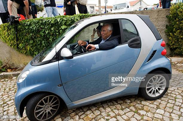 Antonio Costa, leader of the Socialist party , with his wife Fernanda Tadeu, leaves a polling station in a Daimler AG Smart car after casting his...