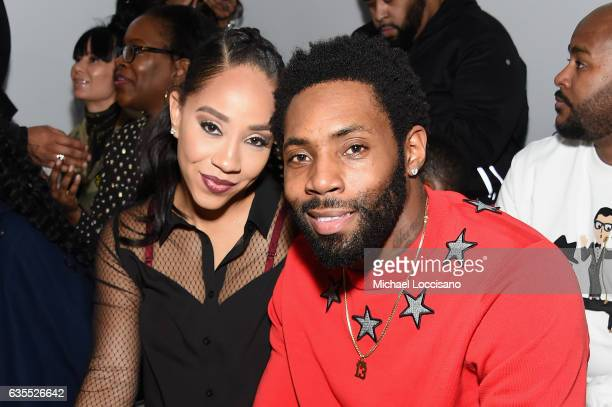 Antonio Cromartie and Guest attend the Rookie USA fashion show during New York Fashion Week The Shows at Gallery 3 Skylight Clarkson Sq on February...