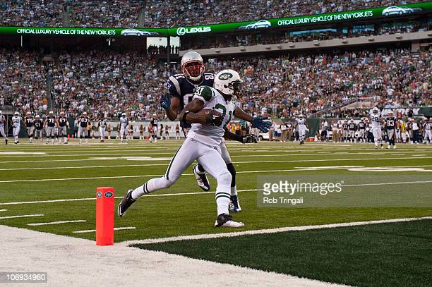 Antonio Cromartie of the New York Jets intercepts a pass to Randy Moss of the New England Patriots during the game on September 19 2010 at the New...