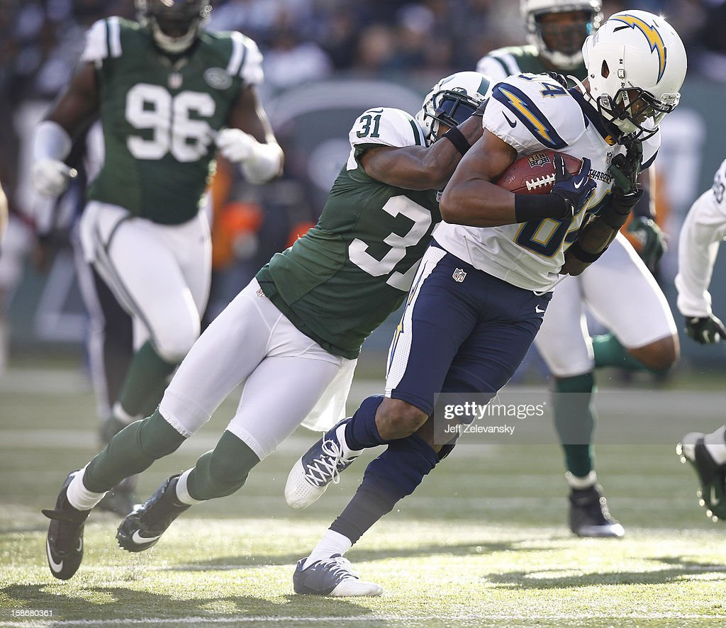 Antonio Cromartie #31 of the New York Jets takes down Danario Alexander #84 of the San Diego Chargers at MetLife Stadium on December 23, 2012 in East Rutherford, New Jersey.
