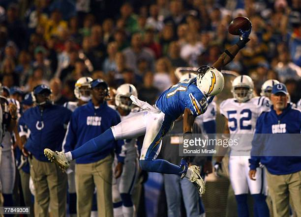 Antonio Cromartie of the San Diego Chargers reaches to intercept a pass from Peyton Manning of the Indianapolis Colts during the 1st half of their...