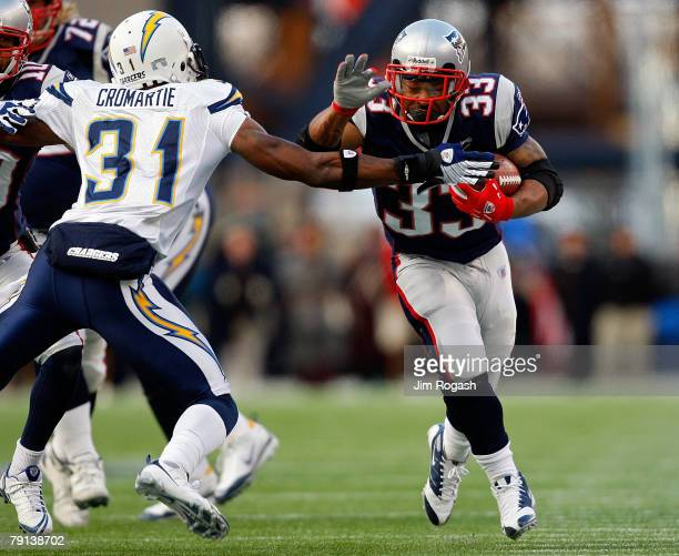 Antonio Cromartie of the San Diego Chargers tackles Kevin Faulk of the New England Patriots during the AFC Championship Game on January 20 2008 at...