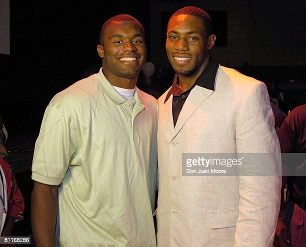 Antonio Cromartie with Florida State cornerback Myron Rolle smiles after being selected 19th overall pick by the San Diego Chargers in the 2006 NFL...