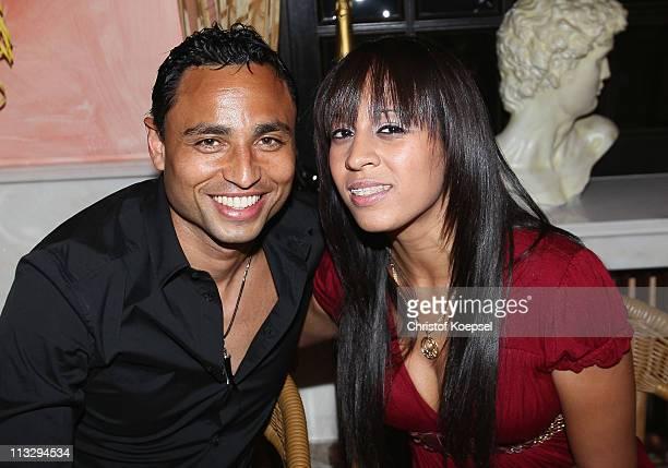 Antonio da Silva and his girlfriend Tatiana pose before celebrate winning the German Championships at a restaurant on April 30 2011 in Dortmund...