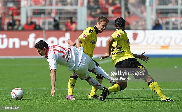 Antonio da Silva and Mario Goetze of Dortmund challenge Mehmet Ekici of Nuernberg during the Bundesliga match between Borussia Dortmund and 1 FC...