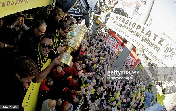 Antonio da Silva celebrates during a victory parade on an open top bus after winning the DFB Cup and Bundesliga Trophy on May 13 2012 in Dortmund...