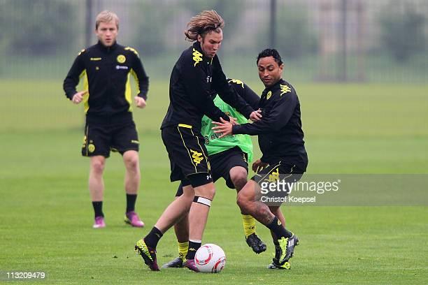 Antonio da Silva challenges Kevin Grosskreutz of Dortmund during a Borussia Dortmund training session at the Dortmund Brackel training ground on...