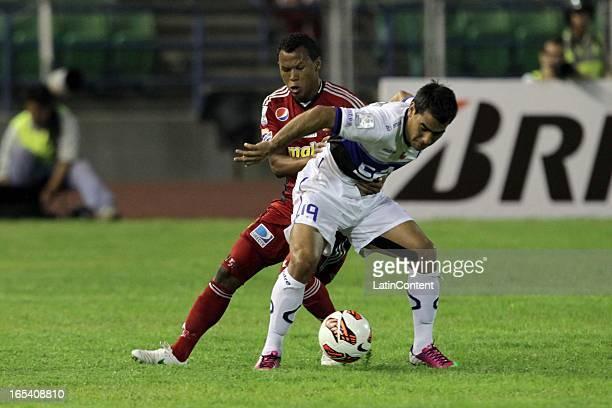 Antonio Da Silva de Caracas FC fights for the ball during a match between Caracas FC and Huachipato as part of the Copa Bridgestone Libertadores 2013...