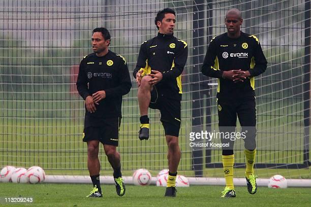 Antonio da Silva Lucas Barrios and Felipe Santana stretch during a Borussia Dortmund training session at the Dortmund Brackel training ground on...