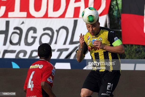 Antonio Da Silva of Caracas FC competes for the ball with Daniel Rouga of Deportivo Tachira during a match between Caracas FC and Deportivo Tachira...