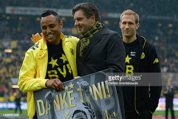 Antonio da Silva of Dortmund and manager Michael Zorc react during a goodbye ceremony prior to the Bundesliga match between Borussia Dortmund and SC...