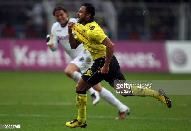 Antonio da Silva of Dortmund celebrates with team mate Roman Weidenfeller after scoring his teams first goal during the Bundesliga match between...