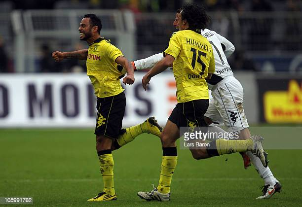 Antonio da Silva of Dortmund celebrates with team mates after scoring his teams first goal during the Bundesliga match between Borussia Dortmund and...